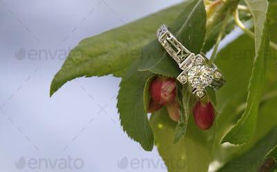 Diamond wedding ring on flower bud branch