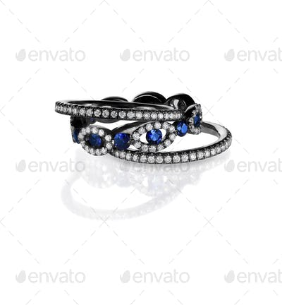 diamond and sapphire ring bands with black metal