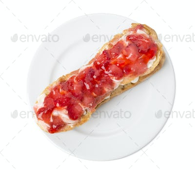 Delicious eclair with strawberry jam.