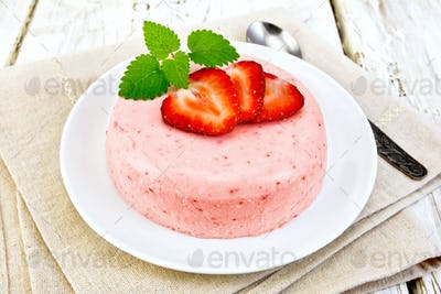 Panna cotta strawberry with mint on light board