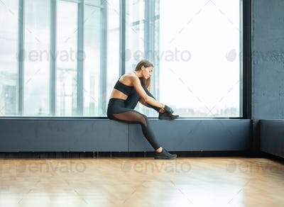 young hispanic athletic sportswoman indoors, gym