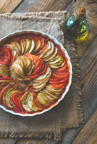 Dish of ratatouille on the wooden table