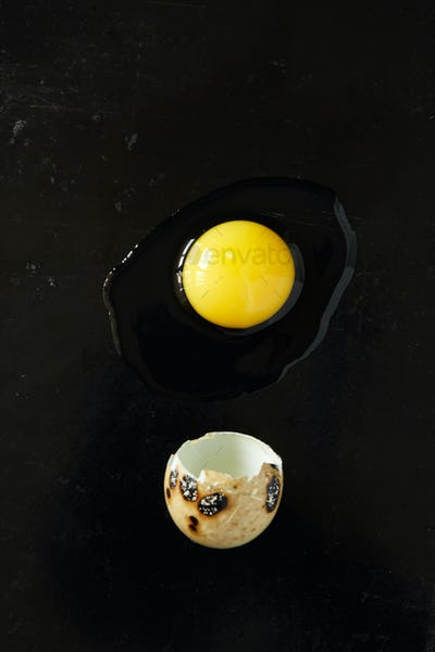Quail egg on black rusty background