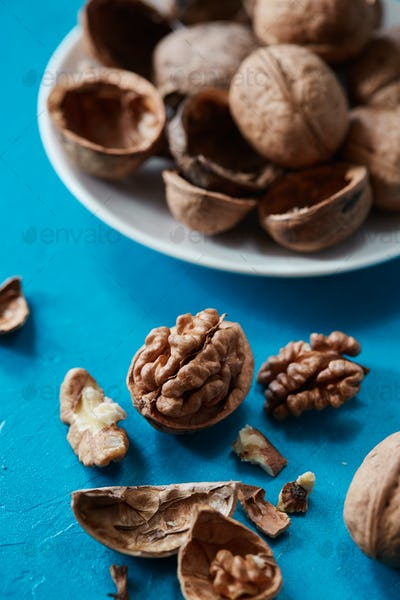 Walnuts on a rustic color backdrop