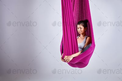 Aerial different inversion antigravity yoga in a hammock