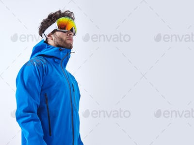 The mountaineer in winter clothes and ski ultraviolet protected mask on white isolated background