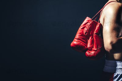 Pair of red gloves on the fighter's back.