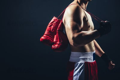Red gloves hanging on the boxer's back.