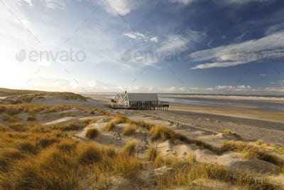 wooden house on North sea beach
