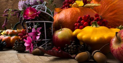 Fall decor with yellow and orange squash and acorn