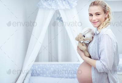 Pregnant woman in child's room