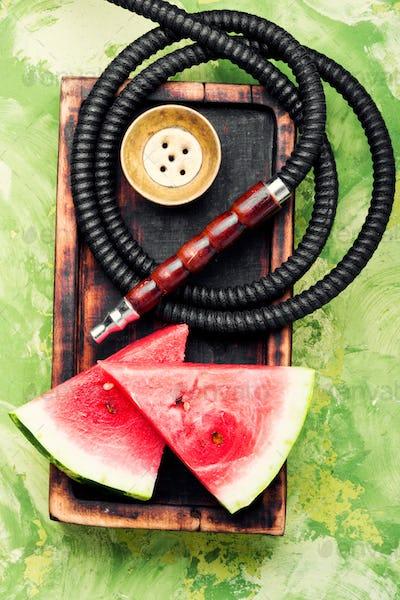 Stylish retro hookah with watermelon flavor