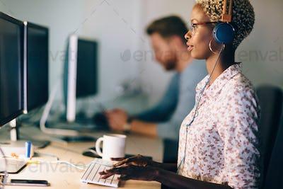 Portait of software designer working in office