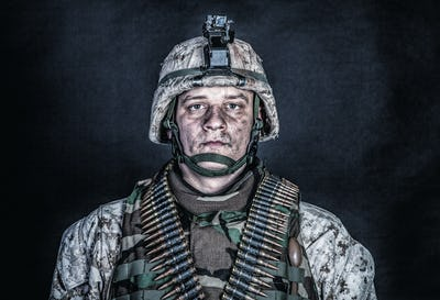 Marine machine gunner with ammo belts on chest
