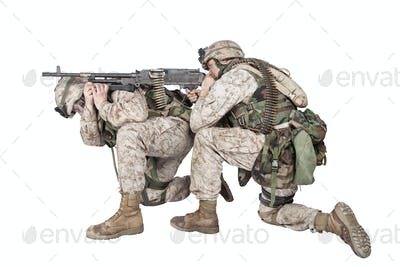 Marines shooting with machine gun studio shoot