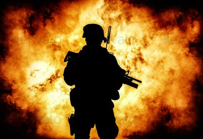 Soldiers silhouette on background of explosion