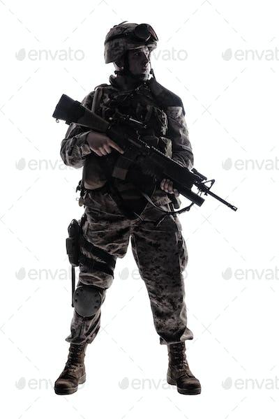 Modern army infantryman low key studio shoot