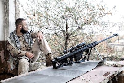 Elite squad sniper resting on city firing position