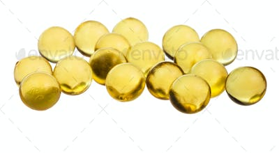many capsules with oil close up isolated