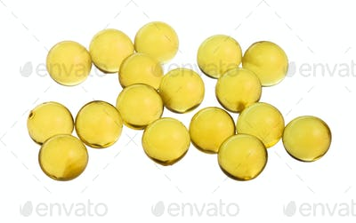 yellow capsules with oil isolated on white