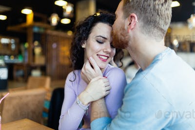 Young couple on date in coffee shop