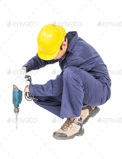 Handyman sitting with his electric drill