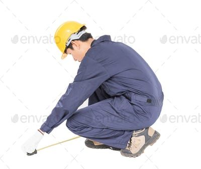 worker in unifrom with tape measure_-6