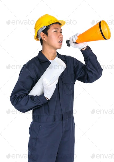 Young worker shouting for announce through a megaphone