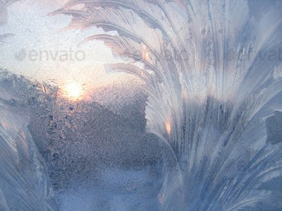 Ice and sun on winter glass