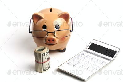 Piggy Bank With White Calculator