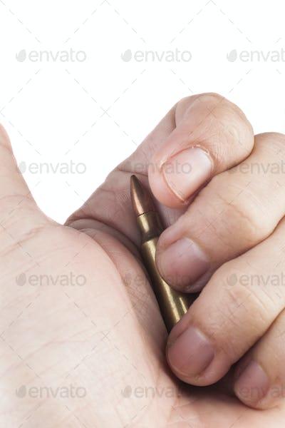 Hand Holding Bullet