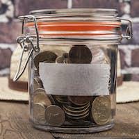 Coins Jar on Table