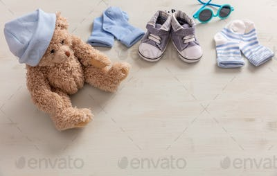 Baby boy shoes and socks on wooden background