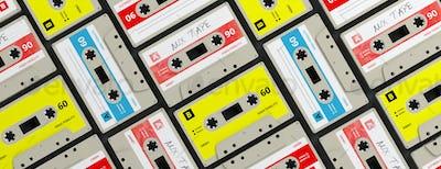 Vintage audio cassettes background, banner. 3d illustration