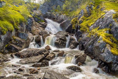 Norwegian Waterfall with long exposure and blurred water flow