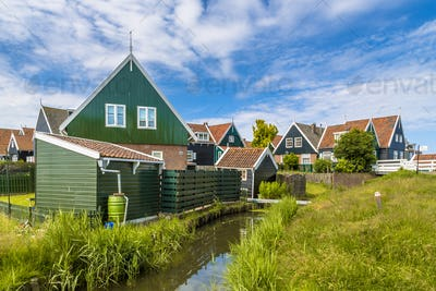 Dutch village scene with wooden houses and canal