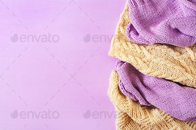 Violet white wool knitting texture.  Sweater textile background. Top view. Flat lay