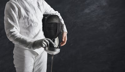 Female fencer in white fencing suit at black background