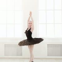 Beautiful graceful ballerina in black swan dress