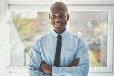 Smiling mature businessman standing confidently in an office