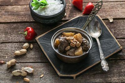 Thai Beef Massaman Curry with Rice, dark background copy space