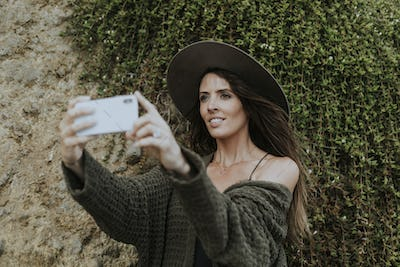 A woman taking photos with her phone