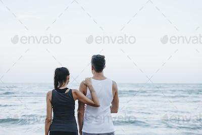 Couple looking towards the horizon