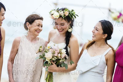 Happy bride and guests at her wedding