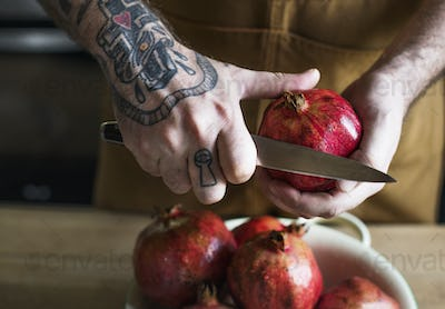 A chef preparing pomegranate food photography recipe idea
