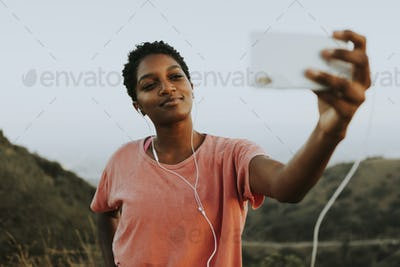 Woman making taking a selfie