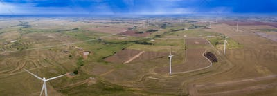 Aerial panorama of wind turbines and rain clouds in Oklahoma, US