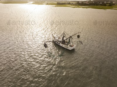 Aerial view of shrimp boat off the coast of South Carolina at su