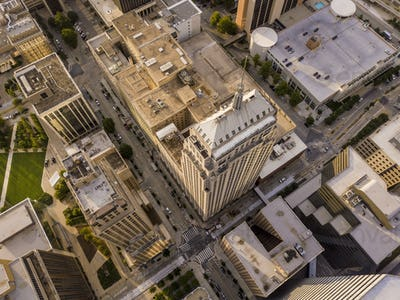 Dramatic close aerial view of skyscrapers in Oklahoma City, stra