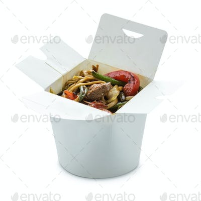 Noodles with beef and with vegetables in take-out box over white